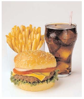 This simple meal demonstrates the complicated relationship between a culture and its food. In the twentieth century, Americans' preference for quick, portable meals popularized the fast-food burger. Over time the popularity of fast foods in America contributed to an epidemic of obesity. [Photograph by Lois Ellen Frank. Corbis/Lois Ellen Frank. Reproduced by permission.]