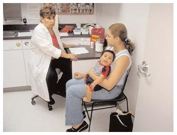 A new mother receives counseling at a WIC clinic. Other services available at the clinics include dental care, immunizations and various health screenings.[Photo by Ken Hammond. © USDA Photography Center.]