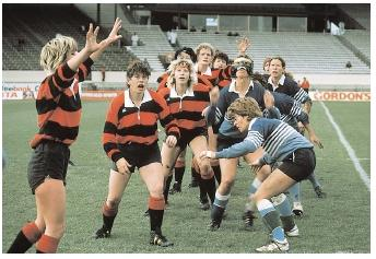Female rugby players form a lineout, waiting for the ball to be thrown. Rugby can improve both aerobic and anaerobic fitness because, like many sports, it requires steady activity as well as frequent bursts of exertion. [© Kevin Fleming/Corbis. Reproduced by permission.]